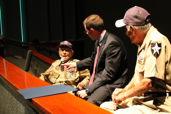 On the 70th anniversary of occupied France's invasion by the US, Texan D-Day veterans Robert Bearden (left) and Johnny Marino (right) told their stories of that day at the Texas state history museum in Austin via the Voice of veterans program (whose representative is at the center of that picture).