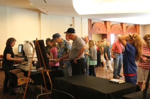 "At the end of the event, participants lined up to purchase Robert Bearden's book: ""To D-Day and Back : Adventures with the 507th Parachute Infantry"", and have it signed, while others enjoyed the Voice of veterans exhibit that will be on display outside the Imax theater while the 3D movie ""D-Day: Normandy 1944"" will be shown, until November."